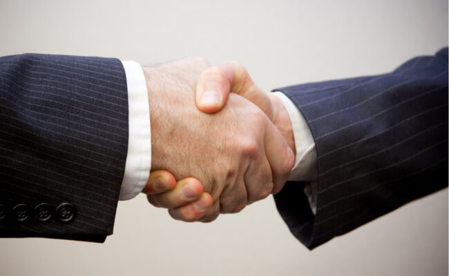 Mopinion: It's time to speak to your digital agency about online customer feedback - Shaking hands